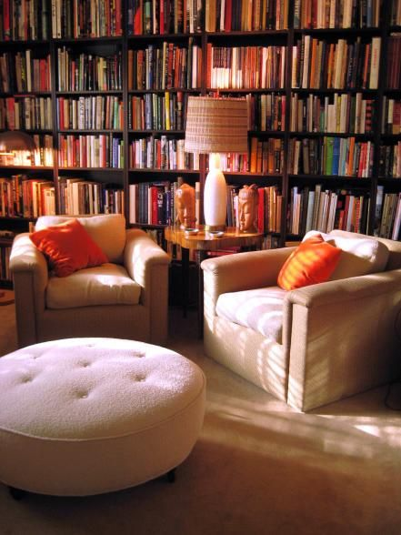A home library can easily become the favorite room of the house. HGTV fan srk1941 uses the room to sit back on the comfortable chairs and read a book next to a table lamp that provides the perfect amount of lighting. The wall of books acts as the only decor in the room, which evokes a calm feel.
