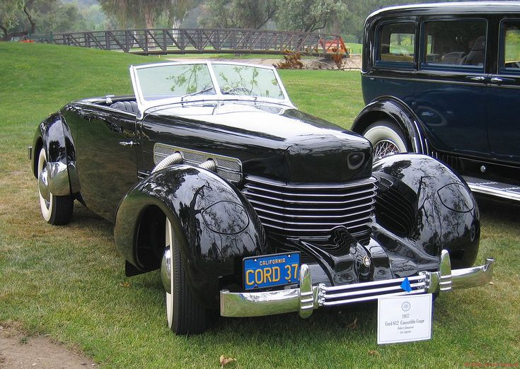 1937 Cord  .. a series of innovative cars. Front wheel drive, hidden headlights, supercharged (exhaust pipes on sides of hood)