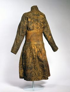 While the typical Arab caftan was closed in the front, the Mongol was closed on the side with a row of tapes, which in this caftan are attached to a reinforced piece around the waist. The pattern demonstrates a mixture of Eastern and Western influences. The drop-shaped elements with stylized lions and surrounding swastika shapes point to China, while the stylized border with Kufi pseudo-calligraphy on the shoulders is an Islamic feature that has its origins in Arab tiraz textiles.