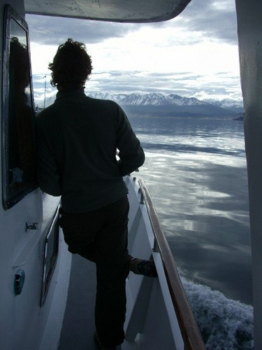 Hes on a boat! This student takes a ride during his study abroad adventure in Brazil.