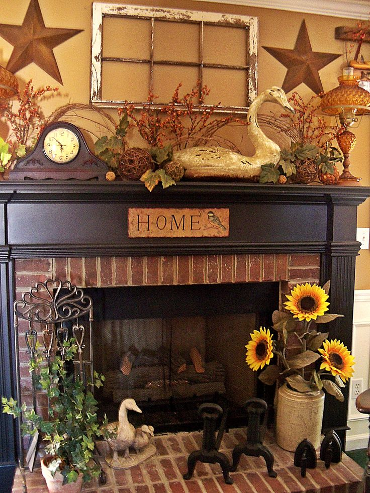 Prim Mantel Display...love the old window & stars above the fireplace.