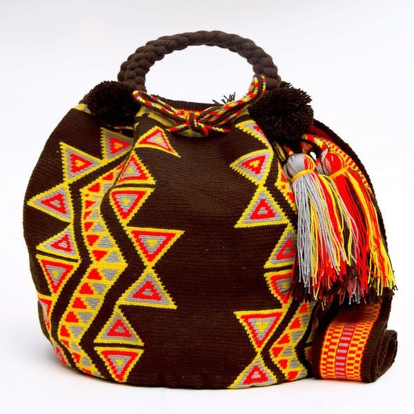 Shop Handmade Wayuu bags! Handcrafted by the indigenous Wayuu Tribe in South America. Style: Mochila Bucket Bags with Tassels and drawstring enclosure.