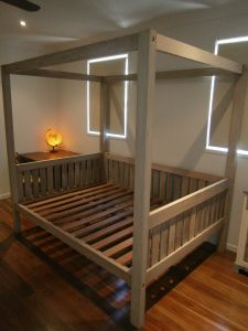 Four poster bed. $1,200.00 Custom made by Illusive Wood Designs