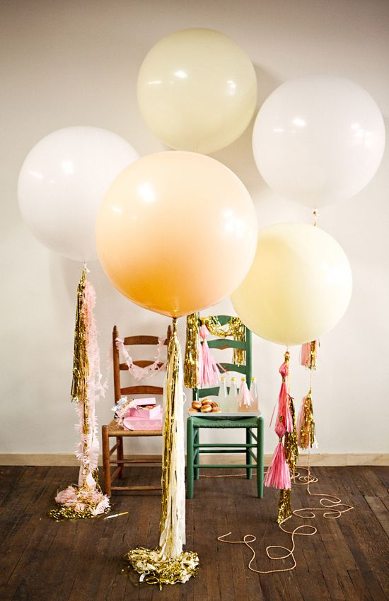 Fill your party space with extra large balloons. They're a fun addition and they make great photo props. Balloons from Geronimo Ballons.
