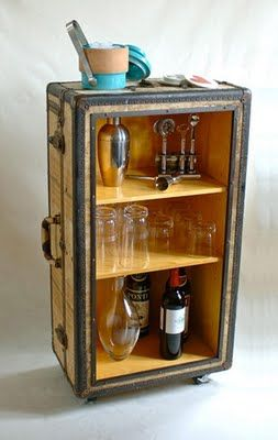 Old suitcase made into Wine storage & display stand
