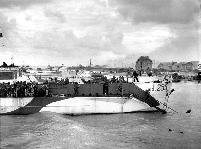 HMCS LCI(L) 299 has not quite nosed into position and the seawater is still pretty deep for the men working on the ramps. The Stormont Dundas & Glengarry Highlanders of the 9th Brigade, 3rd Infantry Division are about to wade ashore on Nan White Sector of Juno Beach in Bernières-Sur-Mer
