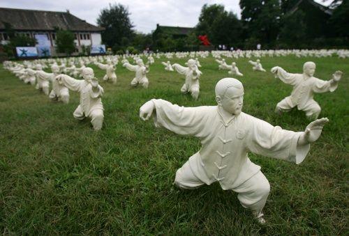Field full of tai chi statues.