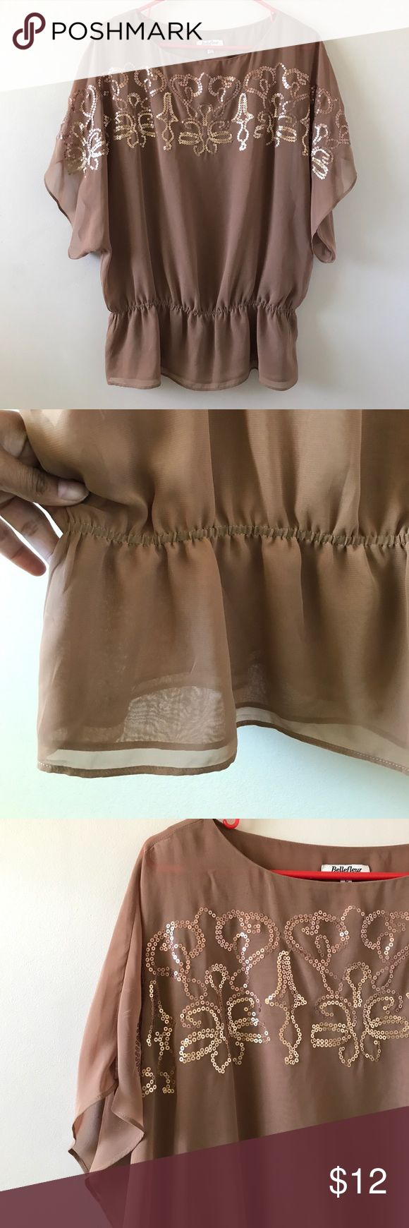 Brown batwing This brown batwing shirt is stunning. Also brown is very in !! It's a size large and it's form bellefleur! Sequence on the front too bellefleur Tops Blouses