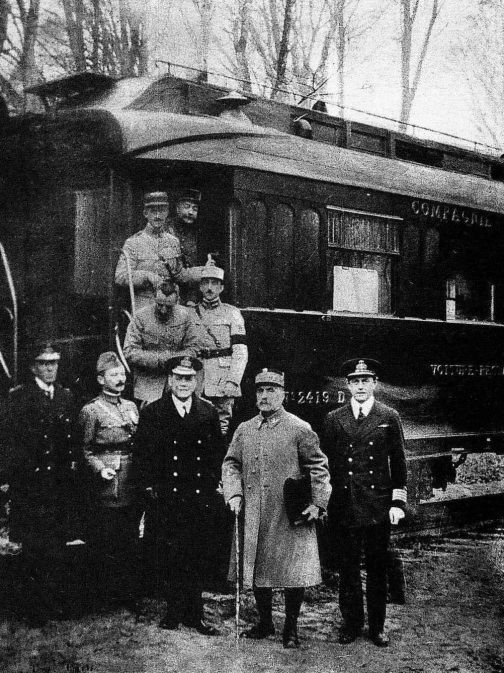 Armistice signatories in front railway car  in the Allied war zone in France's Compiègne Forest on Nov. 11, 1918