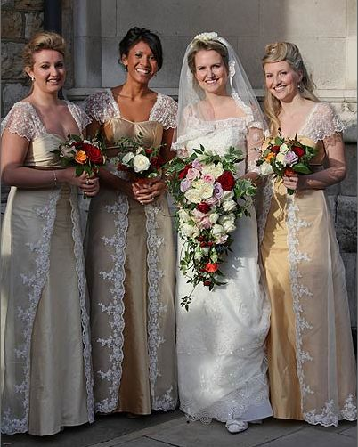 Classic English wedding. A shower bouquet with a selection of roses in autumnal shades of red, orange, peach and pink. Ceremony in Westminster Abbey and reception in No1 Great George Street in London