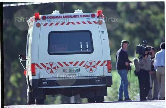 An ambulance leaves the Port Arthur historic site after the Port Arthur massacre, where 35 people were shot an killed by a lone gunman, Tasmania, 29 April 1996. THE AGE Picture by JASON SOUTH