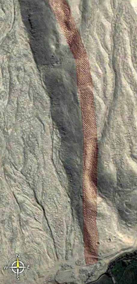 """The """"Band of Holes"""" consists of approximately 6,900 unexplained man-sized holes carved into the barren rock near Pisco Valley, Peru on a plain called Cajamarquilla. It dates back to ancient times and remain a mystery much like neighboring Nazca Lines and Machu Piccu best appreciated from the air and satellite imagery. You might want to locate them with Google Earth."""