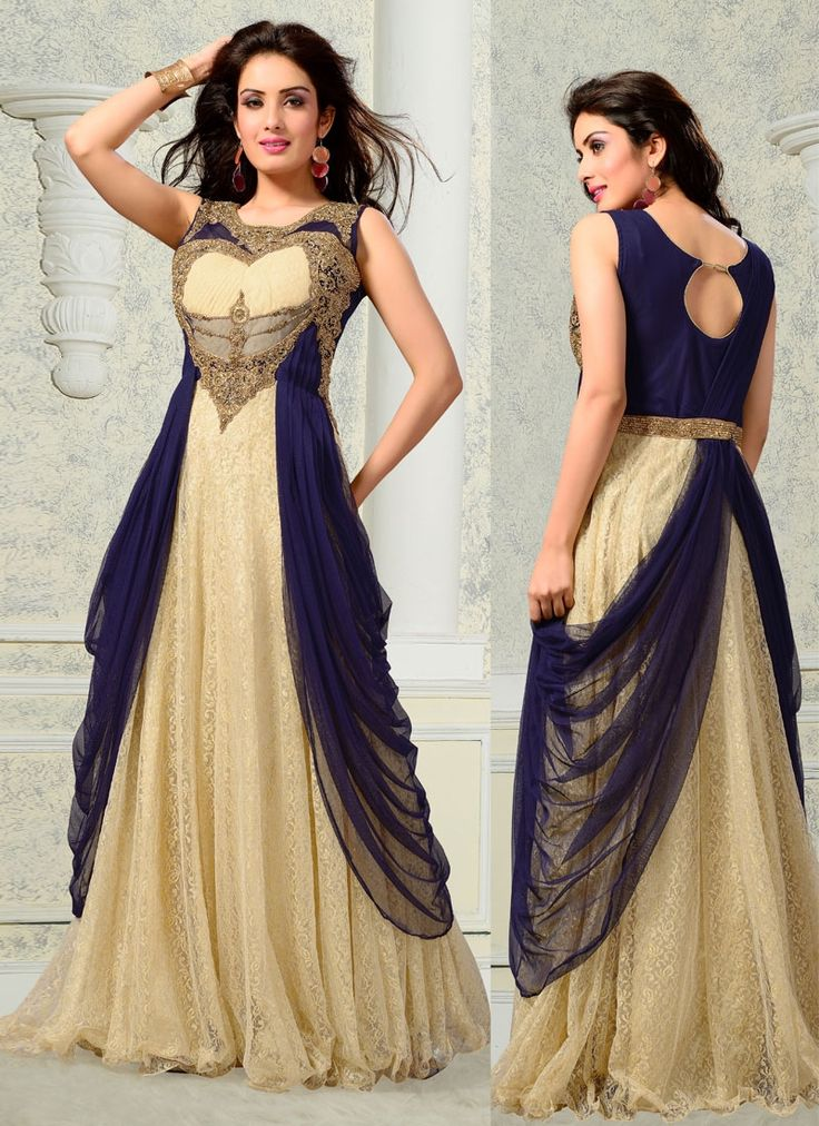 Ethnic NX cream and navy blue fancy net designer gown is designed with embroidery, kasab, resham, stone, cut dana and diamond work. Comes with matching dupatta. (Slight variation in color, fabric & wo...