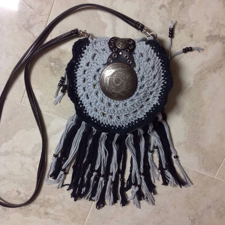 A personal favorite from my Etsy shop https://www.etsy.com/listing/571787998/crochet-small-boho-hippie-fringed
