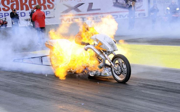 A biker is engulfed in a ball of fire as his 1950cc twin-cylinder machine explodes.  Photo by Andy Willsheer.