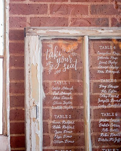 Romantic Industrial Wedding Inspiration - hand lettered signage - vintage window seating chart