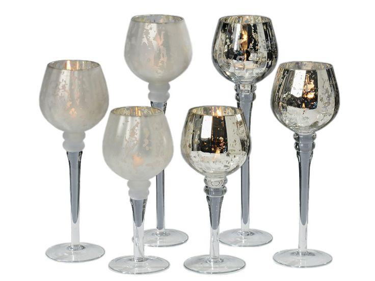 Dacă eşti împătimit de decoraţiuni deosebite atunci nu trebuie să ratezi setul de pahare pentru lumânări Minu. Setul conţine 3 pahare din sticlă, cu picior înalt şi cu înălţimi diferite cuprinse între 20 şi 30 cm.