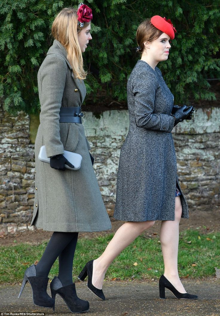 Princess Beatrice (left) teamed her military-style coat, which was cinched in at the waist with a thick black belt, with some vertiginous platform heels and a gingham headband complete with red rose. Her sister Princess Eugenie (right) opted for black court shoes, a grey marl coat, black leather gloves, a red felt cocktail hat by Sarah Cant and a black clutch bag by London designer Stacy Chan