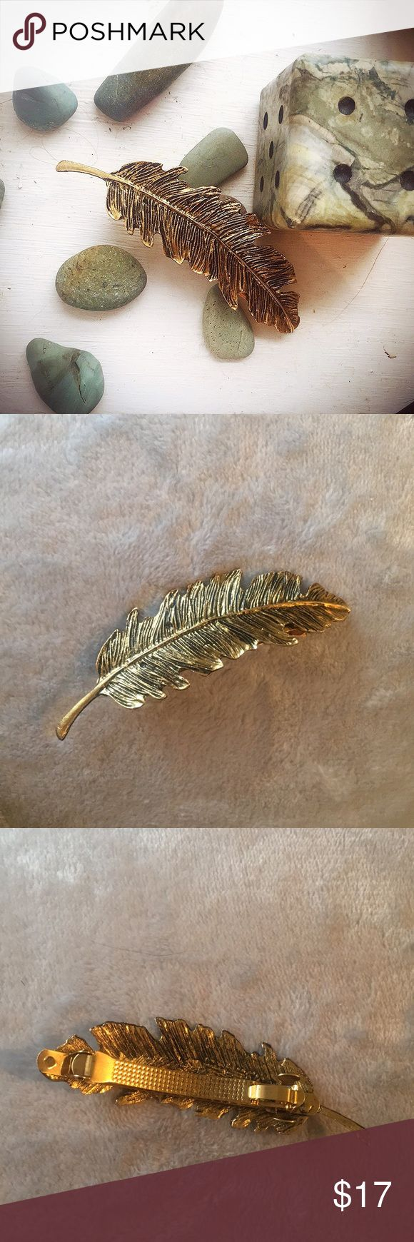 Antique Feather Barrette Gold/Brass colored hand made antique barrette. The second and third pictures are not filtered.  Full disclosure: the old Bobby-pin of this barrette actually broke, so I superglued  the barrette piece on. It is completely unnoticeable when worn. It is not worth it's original antique value after these adjustments, but it's still certainly just as beautiful!   I believe the metal is alloy  Anthro tagged for exposure Anthropologie Accessories Hair Accessories