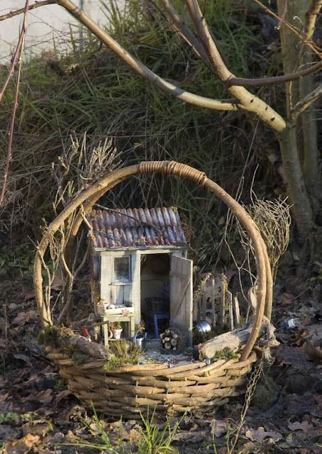 A little house in a basket.. Easy to store for the winter out of the elements-- fairy garden idea