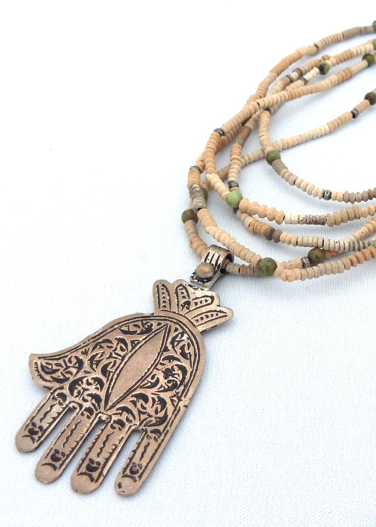 vintage silver Meknes khamsa from Morocco, strung on 5 strands of tiny 'dig beads' from Mali, with turquoise and Thai silver.   www.facebook.com/KIMBERLEYPRICEJEWELLERY
