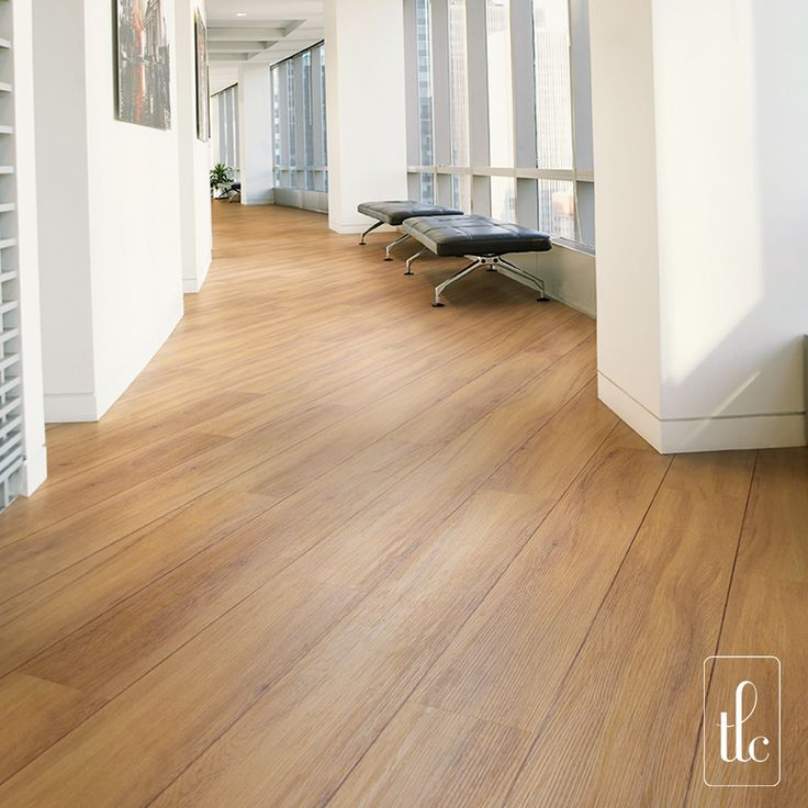 Golden Oak - 5266 -   For a sophisticated yet inviting flooring solution, Golden Oak is a classic choice with warm honey tones and attractive grain patterning, replicated in the surface texture within each plank.  (Straight laid at a 45 degree angle, with Walnut Marquetry Strip)
