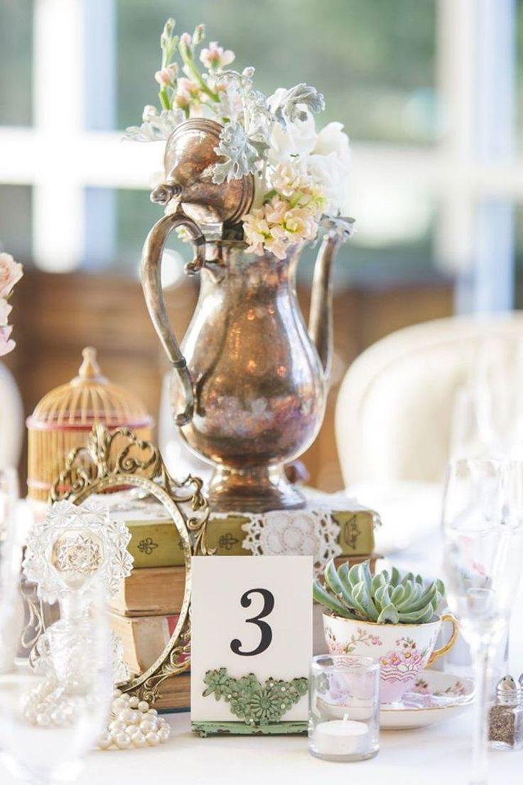 Vintage table scape one of a kind decor from Rent My Dust vintage rentals Romantic Secret Garden Wedding, Silver teapot, succulent, pearls perfume bottles, lace, teacups tea party wedding, rentmydust.com birdcage