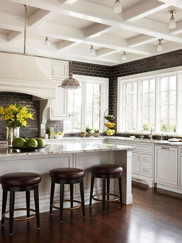 I like this kitchen and the use of brick.  Do used brick.  Interesting in that the black and white kitchens appeal to me.