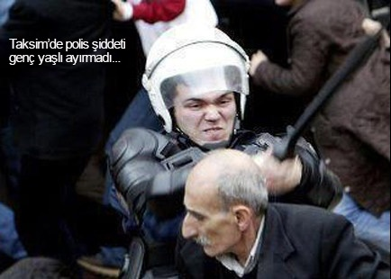 Look at this inhumane face! This is Turkish police.
