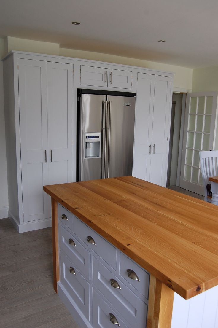 Large Fridges And Freezers Part - 46: A Contemporary American Style Fridge Freezer Is Built In To This Hand  Painted Kitchen By A Surround Of Larder Cupboards. The Island Has An  Interesting ...