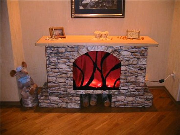 raised fireplace from cardboard boxes with their hands