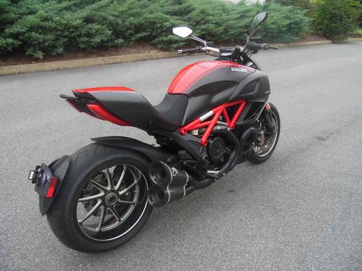 Used 2013 Ducati Diavel Carbon Motorcycles For Sale in Tennessee,TN. 2013 Ducati Diavel Carbon, PLEASE CALL or TEXT Bill OR Todd NOW! Bill: 865.407.6600 Todd: 865.407.6599 or email us at 2013 Ducati Diavel Carbon Standard Features May Include: Carbon details Machine finished forged aluminium Marchesini wheels, reducing weight to 452 lb. Marzocchi forks with diamond-like coating (DLC). Brake disc carriers in milled aluminium. Carbon fibre fairing and black accessories. All these make the…