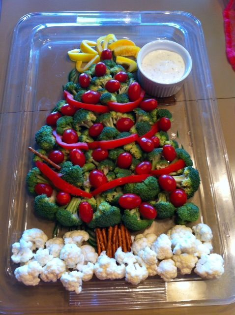 My veggie tray Christmas tree, using red and yellow bell peppers, broccoli, cauliflower, grape tomatoes and pretzels, with yogurt ranch dressing