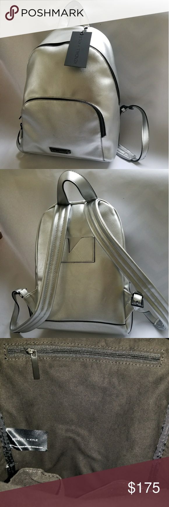 """Kendall & Kylie Silver Backpack Brand new with tags, and dust bag, Kendall+Kylie Smooth Silver Backpack.  -Signature card slot at the back.  - 2 Tiered front zip pockets. -Leather-like silver outer (polyester)  -Suede-like black interior (polyester) with a wall zip pocket, and2 slip pockets.  -Black hardware which Logo plaque at bottom center.  -Top loop with a 3.5"""" drop, and adjustable shoulder straps. Tags: Kendall and Kylie, Kardashian, Jenner, Backpack Kendall & Kylie Bags Backpacks"""