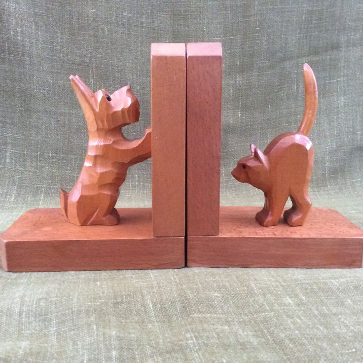 """A charming pair of vintage carved wooden cat and Scottie dog bookends, thought to be from 1950's or 60's. They both have glass eyes.  The height of each stand is 16cm (6.25""""). The length of each base is 13cm (5.25"""") and the width is 8cm (3.25"""")."""