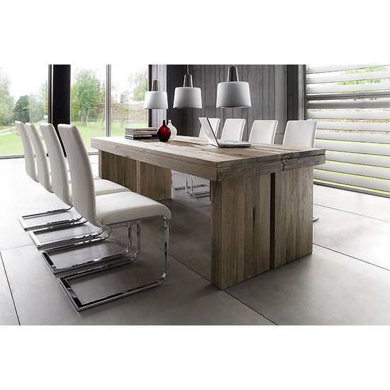 Dublin 8 Seater Wooden Dining Table With 8 Lotte Dining ChairsLotte Metal Swinging Faux Leather Dining Chair, It has Unique Style and Shape Which gives modernise look to any place Finish: Wooden &a...
