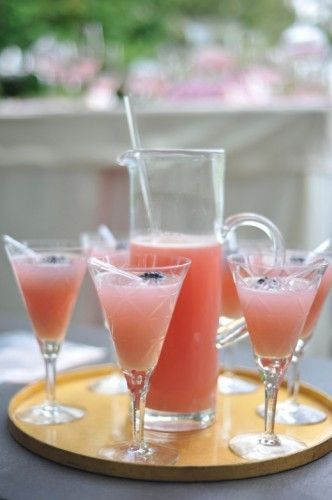 Wedded Bliss  1 ounce Malibu Coconut Rum  1 ounce Absolut Citron  ½ ounce Blue Curacao  Splash of Pineapple Juice  Shaken with ice  Poured into a martini glass with a cherry  Topped off with 7up