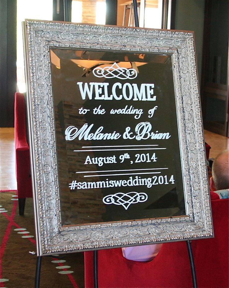 Parisian silver framed mirror wedding welcome.