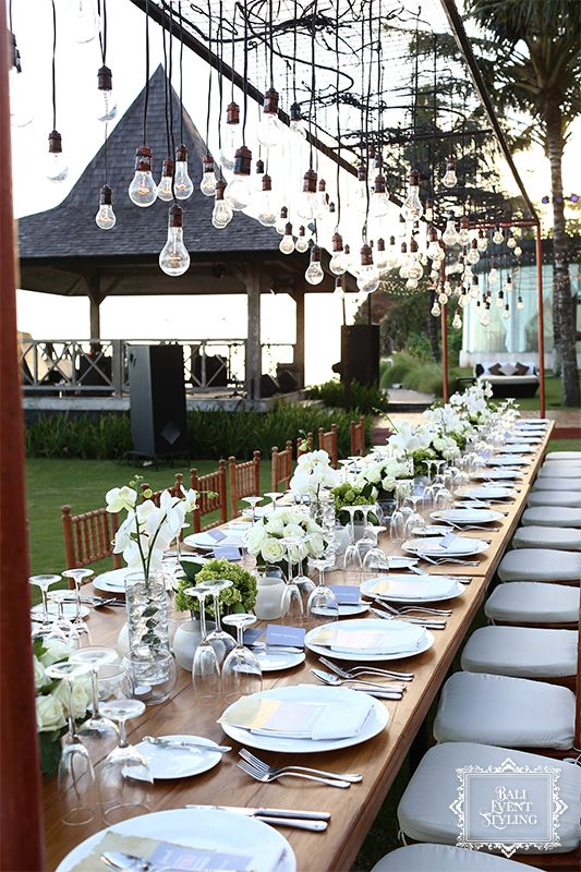 21 best bali destination weddings decor stylings images on dinner set up at a bali beach wedding with hanging lightbulbs for a rustic junglespirit Choice Image