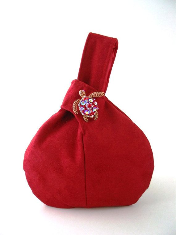 cranberry red wristlet bag decorated with crystal by daphnenen