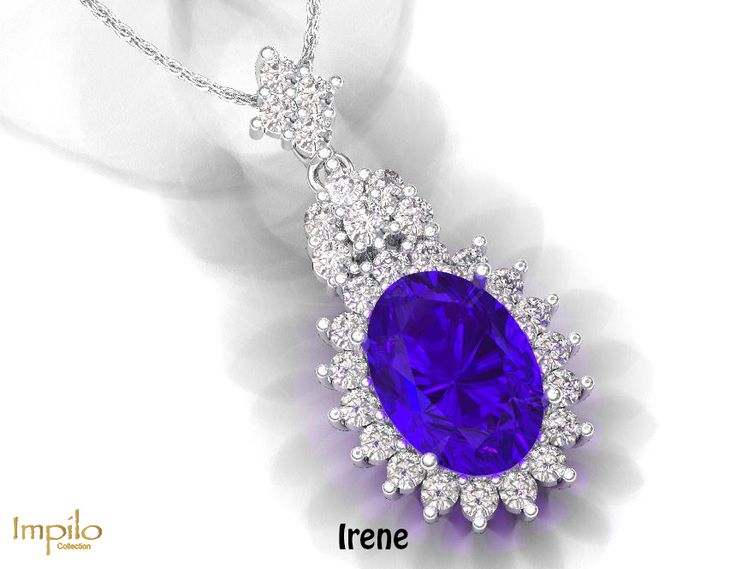 """""""Irene"""" - Oval shaped tanzanite surrounded by round brilliant cut diamonds, with an exquisite deign and bail filled with stunning diamonds."""