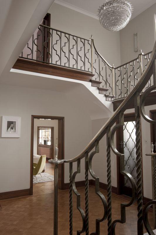 Rundell-Associates-Art-Deco-Dorchester-Drive-Entry-Hall-Metal-Stair-Rails