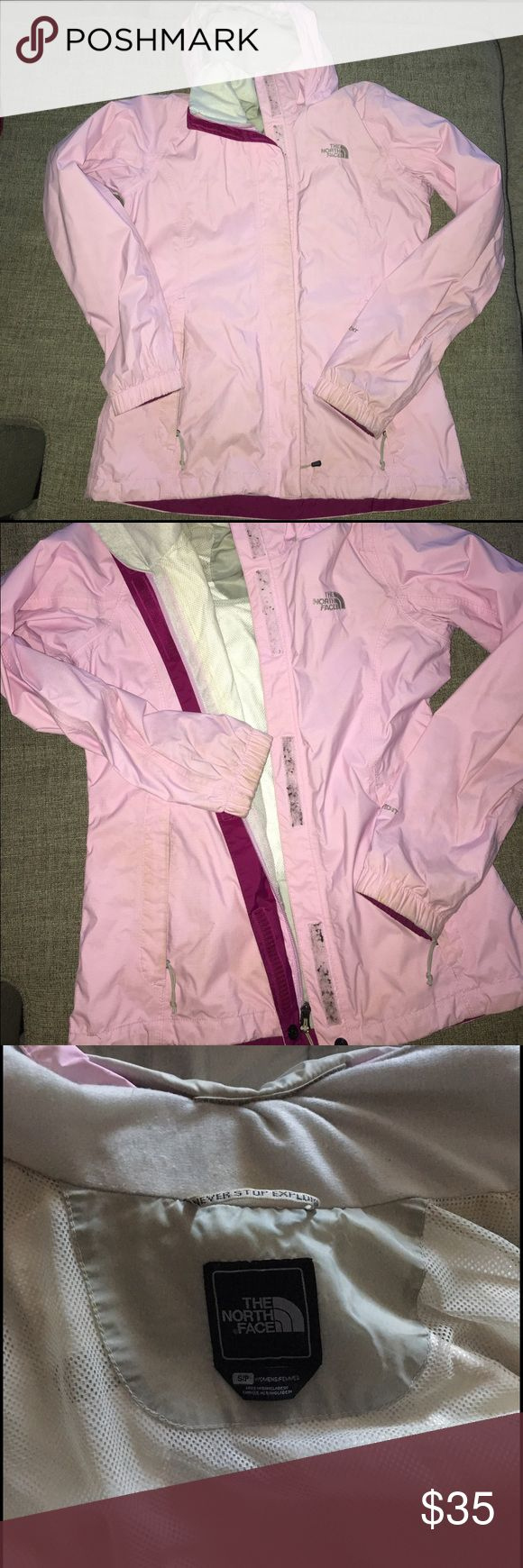 North Face Resolve jacket Preloved pink North Face Resolve rain jacket 💕. Slight staining (from wear) on the bottom of sleeves/wrists and on the zipper part of pockets and fuzzies stuck on the Velcro!! Still totally wearable and useful but too small for me 👍🏼 The North Face Jackets & Coats Utility Jackets