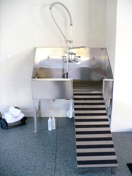Dog Friendly Home With Stainless Steel Dog Shower By Ridalco Over  Decorative Concrete Floors.