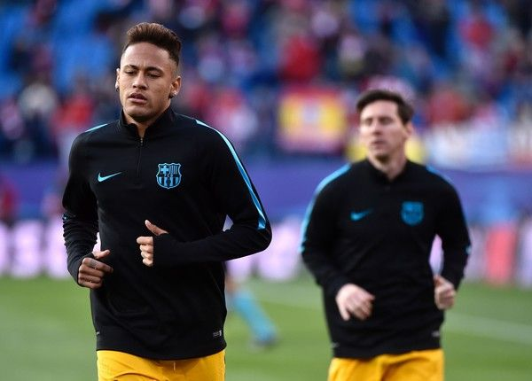 Barcelona's Brazilian forward Neymar (L) and Barcelona's Argentinian forward Lionel Messi run before the Champions League quarter-final second leg football match Club Atletico de Madrid VS FC Barcelona at the Vicente Calderon stadium in Madrid on April 13, 2016.