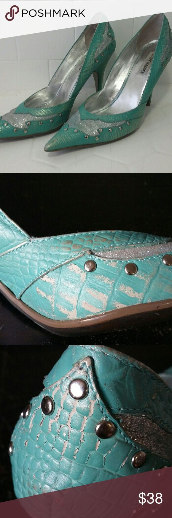 Steve Madden Teal Silver Leather Western Stiletto Steve Madden teal/turquoise/silver Western-style stiletto heels with pointed toe. Faux alligator texture on real leather. Light gold highlights brushed over the blue. Silver glitter on cut-out toe and heel sections, silver studs around cut-outs. Some glitter flaking on one shoe, and some leather scuffing (see photos). Both are somewhat minor and don't detract from the shoes while being worn (the white scuffs blend in with the gold…