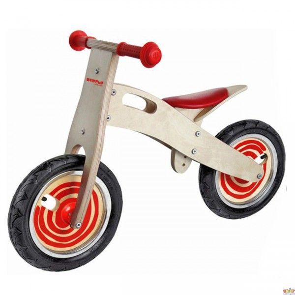 Houten Loopfiets naturel-rood Simply for Kids. Een stoere houten loopfiets met rode accenten zoals het zadel, de wielen en de handvaten.