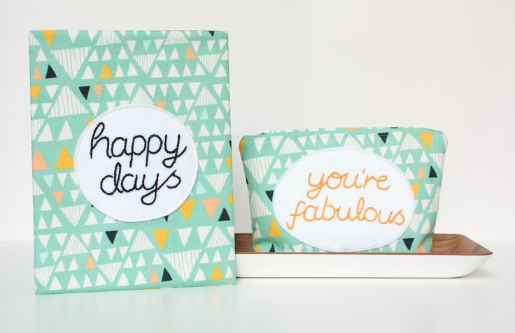 "Cheerful duo to brighten up the day.  ""you're fabulous"" pouch and ""Happy Days"" iPad sleeve."