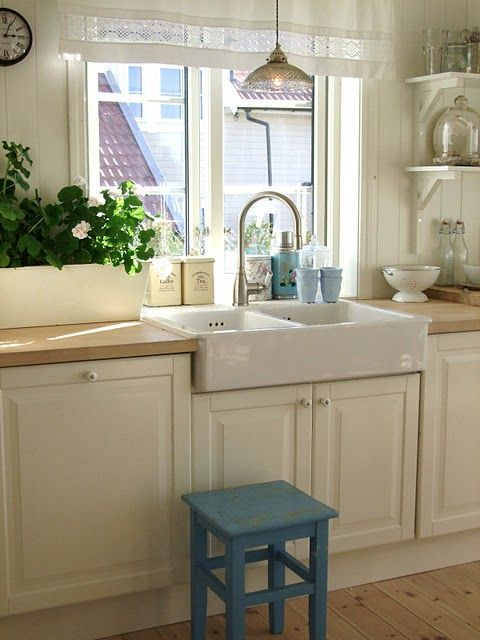 I like the bumped out window for extra space behind the sink.   Like the farm sink and faucet.