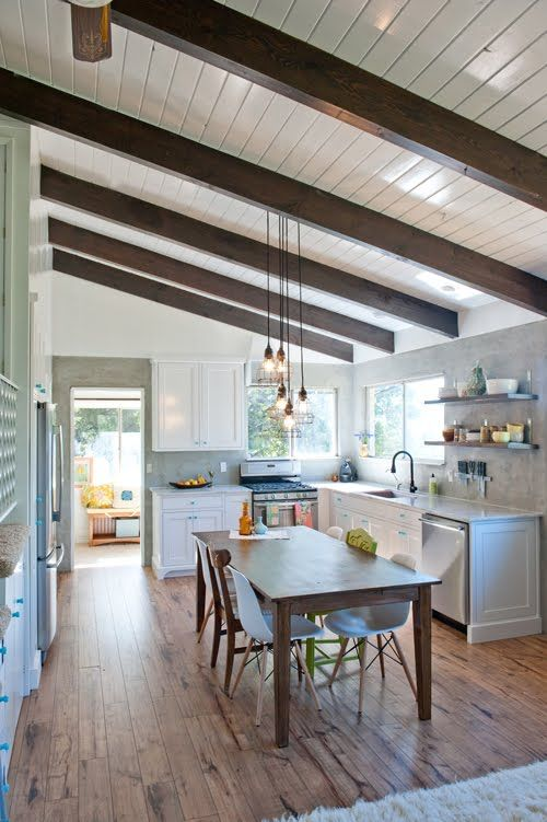 Painted ceiling with stained beams allows lot's of light but gives a rustic feel to the property